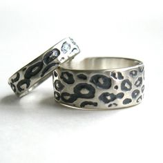 I love these!!  His and Hers Leopard Wedding Rings. my life is complete.