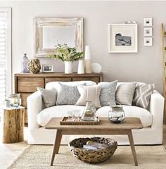 Weathered wood and driftwood for a relaxed coastal living room. Featured on Completely Coastal: http://www.completely-coastal.com/2017/07/neutral-coastal-living-room-house-to-home.html