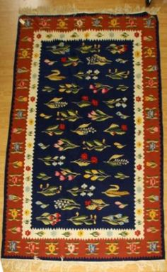 Floral design in bright colors. Blue field with red border. Warp strand tassels are tied in bundles. Rug is in excell. My Design, Floral Design, Kilims, Traditional Rugs, Kilim Rugs, Bright Colors, Tassels, Ethnic, Folk