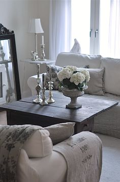 Gorgeous linen covered furniture with vintage grain sack throw