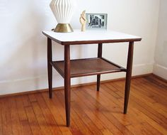 Mid Century Two Tier Wooden Side Table with White Laminate Top. $140.00, via Etsy.