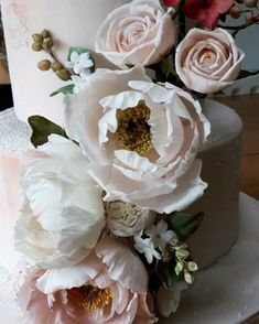 Pretty peach coloured three tiered wedding cake decorated with exquisitely handcrafted sugar flowers.  Sugar peonies, roses, Icelandic poppies and hydrangeas. Pretty Wedding Cakes, Luxury Wedding Cake, Wedding Cake Designs, Icelandic Poppies, Sugar Flowers, Peach Colors, Hydrangeas, Frostings, Cake Art