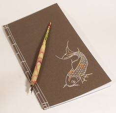 Embroidered Japanese Notebook / Koi Fish on Brown, via Etsy.