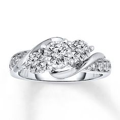 Representing your past, present and future, this 3-stone ring features a trio of round diamonds as its centerpiece. More diamonds grace the 14K white gold band, for a total diamond weight of 1 carat. Diamond Total Carat Weight may range from .95 - 1.11 carats. - Kay Jewelers