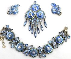 Gorgeous Juliana (D&E) parure of pin/pendant, bracelet and earrings. It features gorgeous baby blue margarita rhinestones accented with blue and ... #auroraborealis #blue #dangle #demiparure #vintage #jewelry