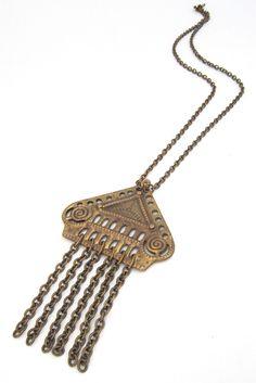 "by: Kalevala Koru, Finland material: bronze size: 5"" x 2 7/8"", chain 29"""