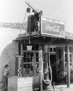 Boy Plays On Gas & Oil Roof wCoke Sign 8x10 Reprint Of Old Photo