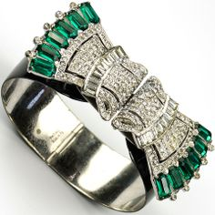 KTF Trifari 'Alfred Philippe' Black Enamel Bangle Bracelet holding two Emerald and Diamante Clipmate Dress Clips