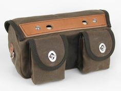 "Acorn Bags - Handlebar (bike) Bag - M A T E R I A L S      MARTEXIN ""ORIGINAL WAX' filter twill (24 oz./yd. after finishing) American manufacturer since 1838      Premium ""ENGLISH BRIDLE"" leather (8-9 oz.) 100% vegetable-tanned from top-grade U.S. steer hides  S P E C I F I C A T I O N S      Dimensions (main compartment): 11""w x 6""h x 4.5""d      Dimensions (inc. pockets): 11""w x 6""h x 6""d      Capacity: approx. 4.5 L      Weight: 20 oz"