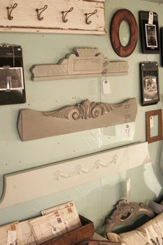 Old Over The Door Pediments...now as primitive architectural wall art!  Love the piece with the old door hooks.