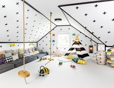 The black and white checks / floor cushions / everything in this kids room from Chango & Co is amazing
