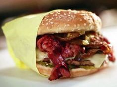 The Guido Burger — Hodad's (San Diego) : Inspired by Guy himself, this pastrami burger is served with ketchup, pickles, Swiss cheese, grilled onions and spicy brown mustard. Gourmet Burgers, Burger Recipes, Beef Recipes, Cooking Recipes, Slider Recipes, Wing Recipes, Burger Dogs, Good Burger, Burger Bun
