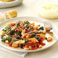 Penne with Tomatoes & White Beans Recipe -I learned how to make this dish from friends in Genoa, Italy, where they're known for creating tasty combinations of veggies, pasta and beans. You can sub feta cheese to give this a Greek twist. — Trisha Kruse, Eagle, Idaho