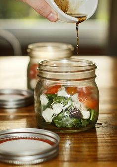 Caprese Salad in a Jar: Ingredients: 2 cups of arugula, 1/2 cup green basil (leaves only), 1/2 cup purple basil (leaves only), 1/2 cup cherry tomatoes, halved, mini bocconcini, Directions: visit chubbyvegetarian.blogspot.com/