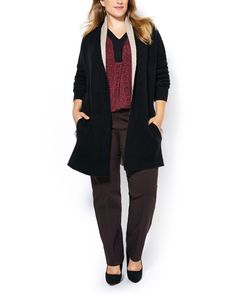 Layer your looks with this cozy plus-size cardigan made with a soft knit fabric…