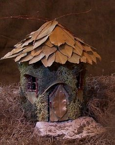 This little pixie house is made from a card stock base with moss, bay leaves, and a few twigs added for decoration plus a glue gun to adhere everything together. Approx. 2-3 hours to make.