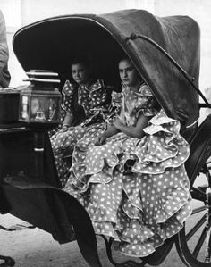 Andalusia. Two girls in flamenco dresses at fiesta of the vintage, a sherry festival held in Jerez after grape harvest, 1948.