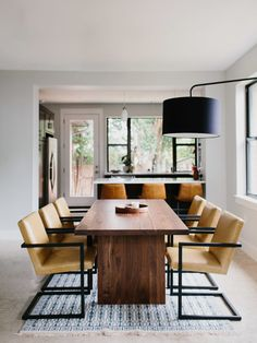 Walnut Mid-Century Modern Room & Board Corbett Dining Table with Leather Lira Chairs and Tulum Rug