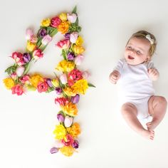 Baby monthly pictures. Fresh flowers. Baby girl. Four months.
