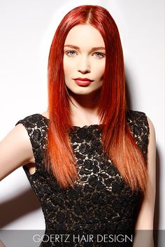 A fire engine red hue shines on this long, smooth and sleek canvas of strands that celebrate the brilliance of vibrant hair color.