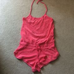 VICTORIAS SECRET Coral drawstring romper Terry cloth drawstring romper in coral! Drawstring waist & a halter string tie around neck. Adorable for a swimsuit coverup or dress up with a pair of wedges ☀️👙 Victoria's Secret Tops