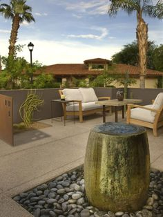 Browse pictures at HGTV of front and backyard landscaping ideas along with hardscape design including water features, pergolas, fire pits and more. Patio Fountain, Fountain Design, Fountain Ideas, Landscape Design, Garden Design, Contemporary Patio, Contemporary Water Feature, Modern Patio, Meditation Garden