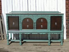 My all time favorite piece. Ornate buffet, dark stained top and drawers, muted turquoise body distressed and glazed. Modern Vintage.
