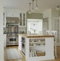 like the white cabines, wall color, built in fridge, butcher block counters