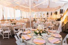 Florida destination beach wedding at waterfront hotel venue Hilton Clearwater Beach. Outdoor wedding ceremony with elegant blush & gold beach reception.