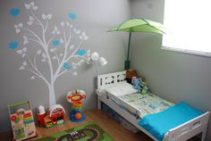 LP's room  Homemade quilt.  Ikea Kritter Bed Surface Inspired wall decal (Etsy)