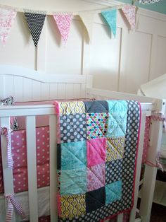 Baby quilt! 5 inch squares, 6 rows across and 6 rows down. Add a boarder and trim the outside.