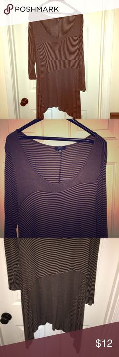 Long Sweater Tunic Brown and black striped tunic with asymmetrical bottom and 3/4 sleeves. Lightweight sweater material. Long and flowy. Perfect over leggings. One small darker spot pictured. Not noticeable except under bright flash. Size XL. Intro Tops Tunics