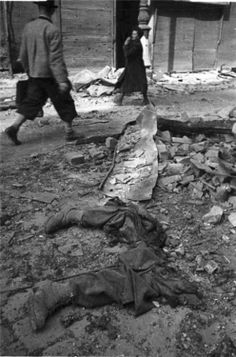A terrible picture of the World War 2 in hi rez. Cut off his feet of German tankman lying on the streets of liberated Vienna.  Location: Vienna, Austria Date: 1945 Author: Eugene Khaldey