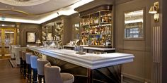 gold/taupe walls with white marble counter top for bar