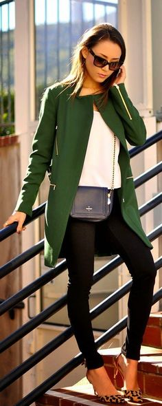 Green blazer and white sweater with black skinny jeans and leopard pumps.
