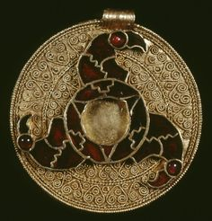 Gold disc pendant with cloisonné triskele of bird heads. Anglo-Saxon, early 7th century, Kent, King's Field.