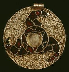 Gold disc pendant with cloisonné triskele of bird heads, King's Field, Faversham, Kent, 7th century