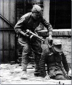 Soviet troop pulls German soldier from manhole, Battle of Berlin, April 1945: