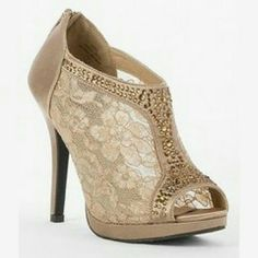 Daytrip heels Size 6 heels by daytrip. Taupe lace and rhinestones. Never worn. Zipper on heel. No flaws, scuffs or other damage. Shoes Heels