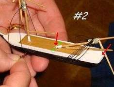 Building a Ship in a Bottle. Ship In Bottle, Whittling Projects, Model Ship Building, Maker Shop, Bamboo Crafts, Model Ships, Sailing Ships, Clothes Hanger, Wooden Toys