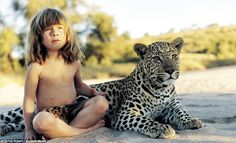 The REAL Mowgli: Incredible images of the little girl who spent the first ten years of her life growing up in the African bush