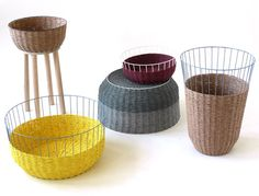 """The Bask collection is a mix between a modern, wire-framed basket and a traditionally-woven basket. After visiting a company in Spain that produces yarn with paper in it, he was inspired to make these baskets. What's cool is you can flip them upside down and use them as side tables."""