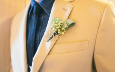 Old bicycle brooch up cycled into a hip boutonniere with seeded eucalyptus