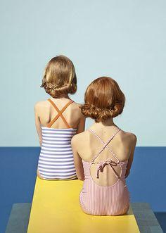 girls swimwear against David Hockney inspired backdrop