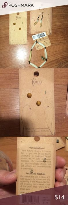 Terra brand bracelet owl charm and earrings NWT All terra brand products made from seeds from the Amazon rainforest. Pearl type studs made from seeds. Kind of a taupe/tan color, dangly earrings creamy and tannish taupe, and stretchy creme/ram bracelet with metal owl charm. See my other listings to coordinate with other terra pieces. Bundle and save terra Jewelry