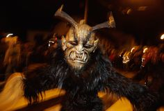 Participants dressed as Krampus walk the streets in search of delinquent children during a Krampus run on November 28, 2015, in Salzburg, Austria.