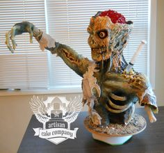 Zombie Cake - This cake was made for display at a cake show. The skin is modeling chocolate, the brains are made of jello. Check out the website: artisancakecompany.com/