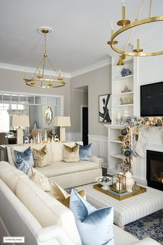 Elegant Christmas living room - Christmas decor with light blue, gold and warm white. Elegant Christmas living room using soft blues, gold, silver and warm whites sets a sophisticated scene with this oh-so-chic color palette! Blue Living Room Decor, Living Room Designs, Glam Living Room, Elegant Living Room, Living Decor, Silver Living Room, Gold Living Room Decor, Christmas Decorations Living Room, White Living Room Decor
