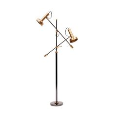 Strike a harmonious chord with this industrial floor lamp. The black patina and brass blend beautifully to create a stylish light fixture suitable for any space.