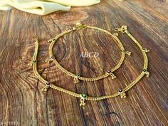 Anklets & Toe Rings Women's Alloy Gold Plated Anklets & Toe Rings Material: Alloy Size: Free Size Description: It Has 1 Pair Of  Women's Anklet Work: Stone Work Country of Origin: India Sizes Available: Free Size   Catalog Rating: ★3.9 (5120)  Catalog Name: Women's Alloy Gold Plated Anklets & Toe Rings CatalogID_223722 C77-SC1098 Code: 641-1711110-